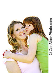 Mother and daughter hugging - Portrait of happy child...