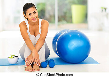 fit woman with exercise ball at home - attractive fit woman...