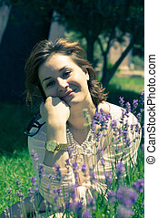 Beautiful woman in lavender field - Beautiful young woman in...