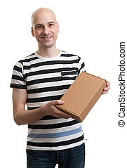 Smiling handsome male with box. Isolated on white