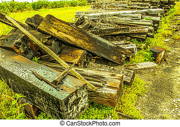 old railroad ties on side of old railroad tracks