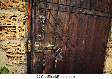 wooden door with lock - stone house wooden door with an iron...