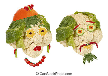 Creative food. Portrait two old man made ??of vegetables and...
