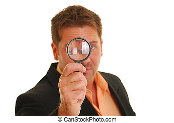 Bussiness man holding a magnifying glass isolated on white....