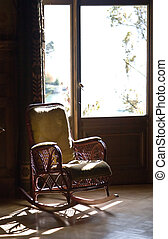 Rocking chair against the window