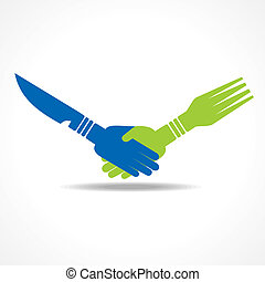 Businessman handshake through forks - Businessman handshake...