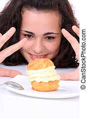 Young girl eating cake - Young girl eating a yumy cake