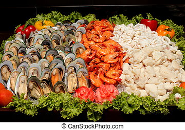 Seafood on ice at the fish market - A Seafood on ice at the...
