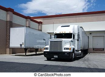 Truck at loading bay - Truck at warehouse loading bay