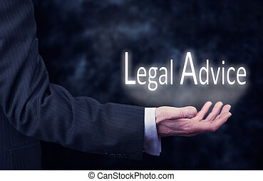 Legal Advice - A businessmans hand holding the words, Legal...