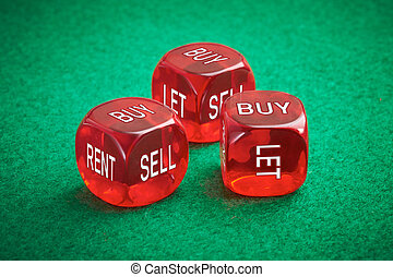 Dice Concept - Housing market concept, three red dice on a...