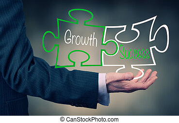 Growth And Success - A Businessman holding a growth success...