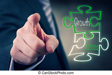 Growth And Success - A Businessman pointing at a growth...