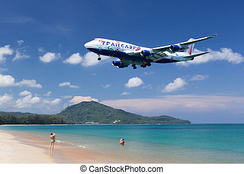 Flying aircraft over the beach coming to Phuket airport...
