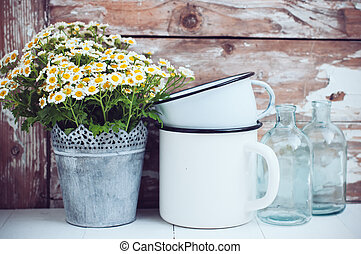home decor - Flowers in a tin can, glass bottles and vintage...