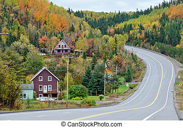 Autumn road - Autumn endless road under cloudscape, Quebec,...