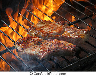 A top sirloin steak flame broiled on a barbecue, shallow...