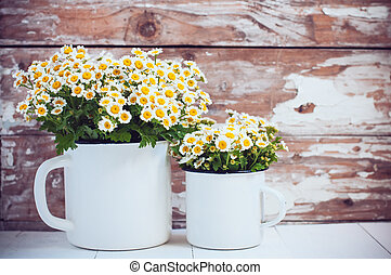 enamel mugs with chamomile flowers - Two vintage enamel mugs...
