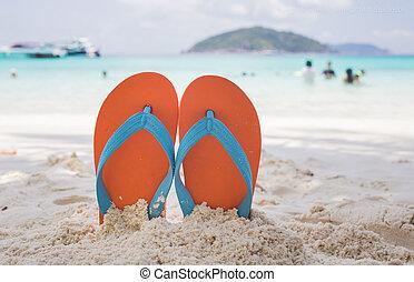 Flip-flop on the beach - Orange flip-flop on the white sand...
