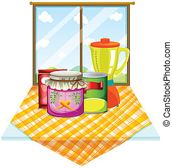 A table near the window with foods inside the containers