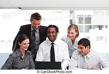 Multi-ethnic business team in an office - Multi-ethnic...