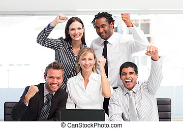Happy business team celebrating a success in office - Happy...
