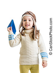 child girl dressed as pilot and playing with paper airplane isol