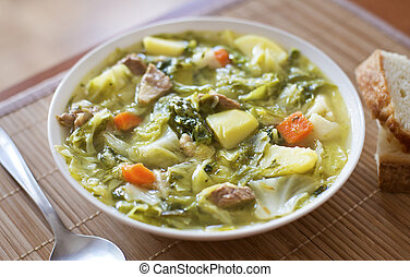 cabbage soup - Cabbage soup with meat and potatoes close up