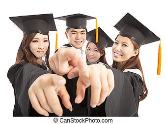 happy group graduate students point to the same direction