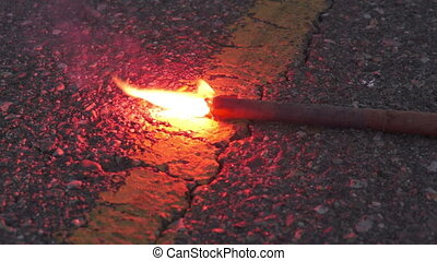 Burning Emergency Road Flare - Close up evening shot of an...