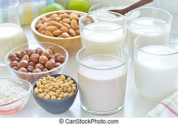 Different vegan milks. - Different vegan milks on a table....