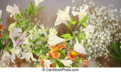 Flowers on decorative basket - Various flowers in white...