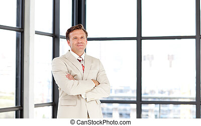 Business manager with folded arms looking at the camera -...