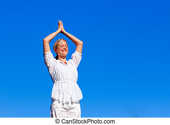 Young girl practising yoga outdoors with copy-space - Young...