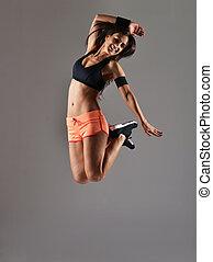 beautiful fitness woman jumping