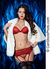 white coat - Seductive young woman in a sexual red lingerie...