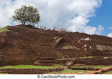 Group of tourists visiting Sigiriya complex - SIGIRIYA, SRI...