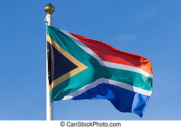 South African flag on the blue sky