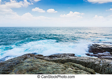 Rock and sea with blue sky