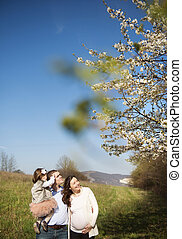 Happy family - Happy pregnant family having fun in spring...