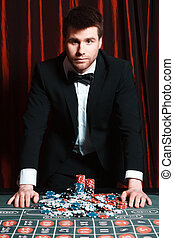 man playing at the casino. studio shot