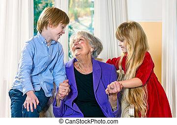 Grandchildren visiting their elderly grandmother