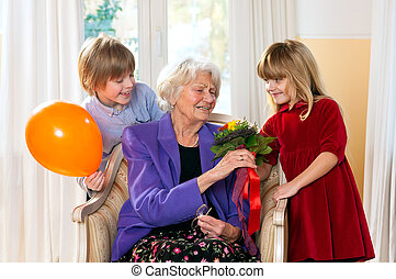Grandma receives flowers from grand kids - Grandma feels...