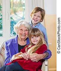 Portrait of a grandmother with her grandchildren