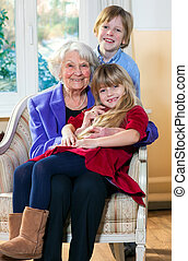Grandmother with Two Children Having Fun indoors.
