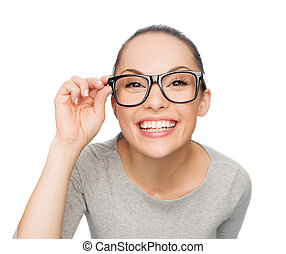 asian woman in adjusting eyeglasses - happiness, health and...