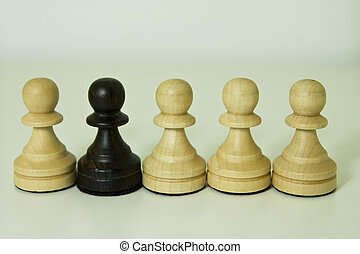 Against Racism - Chess pawn shows abstractly against racism.