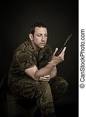 Spanish military with gun on black background