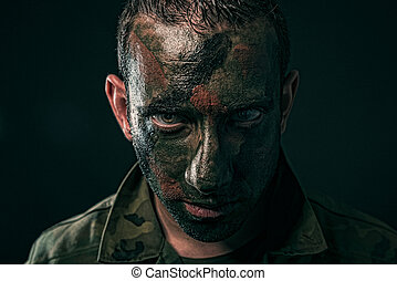 Spanish military with camouflage paint on face on black...