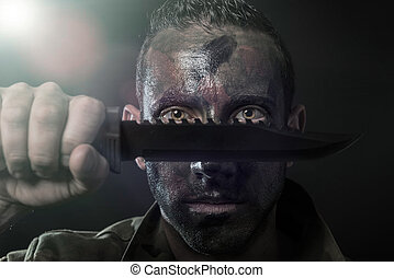 Spanish military with knife on black background